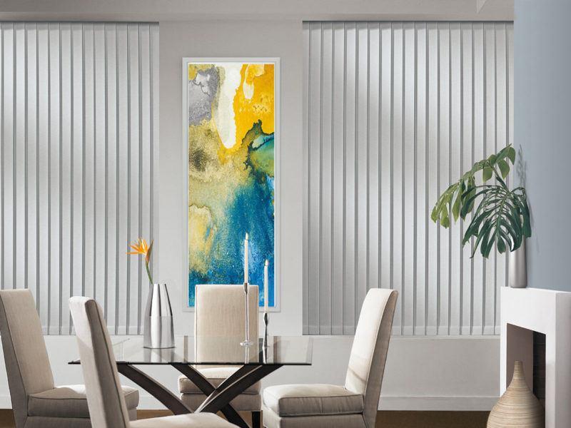 a dining room with Hunter Douglas somner vertical blinds