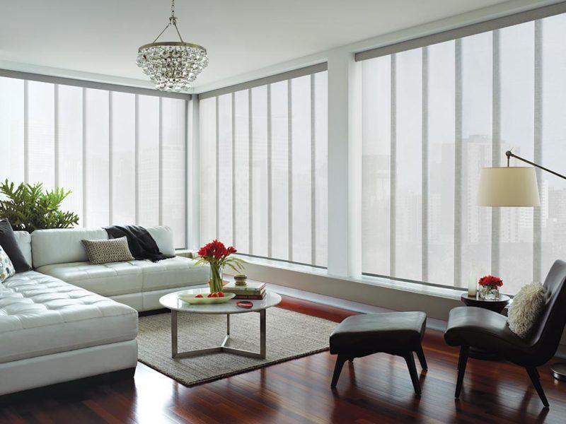 a living room with Hunter Douglas vertical skyline blinds