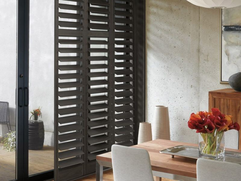 Newstyle™ Hybrid Shutters in a dining room
