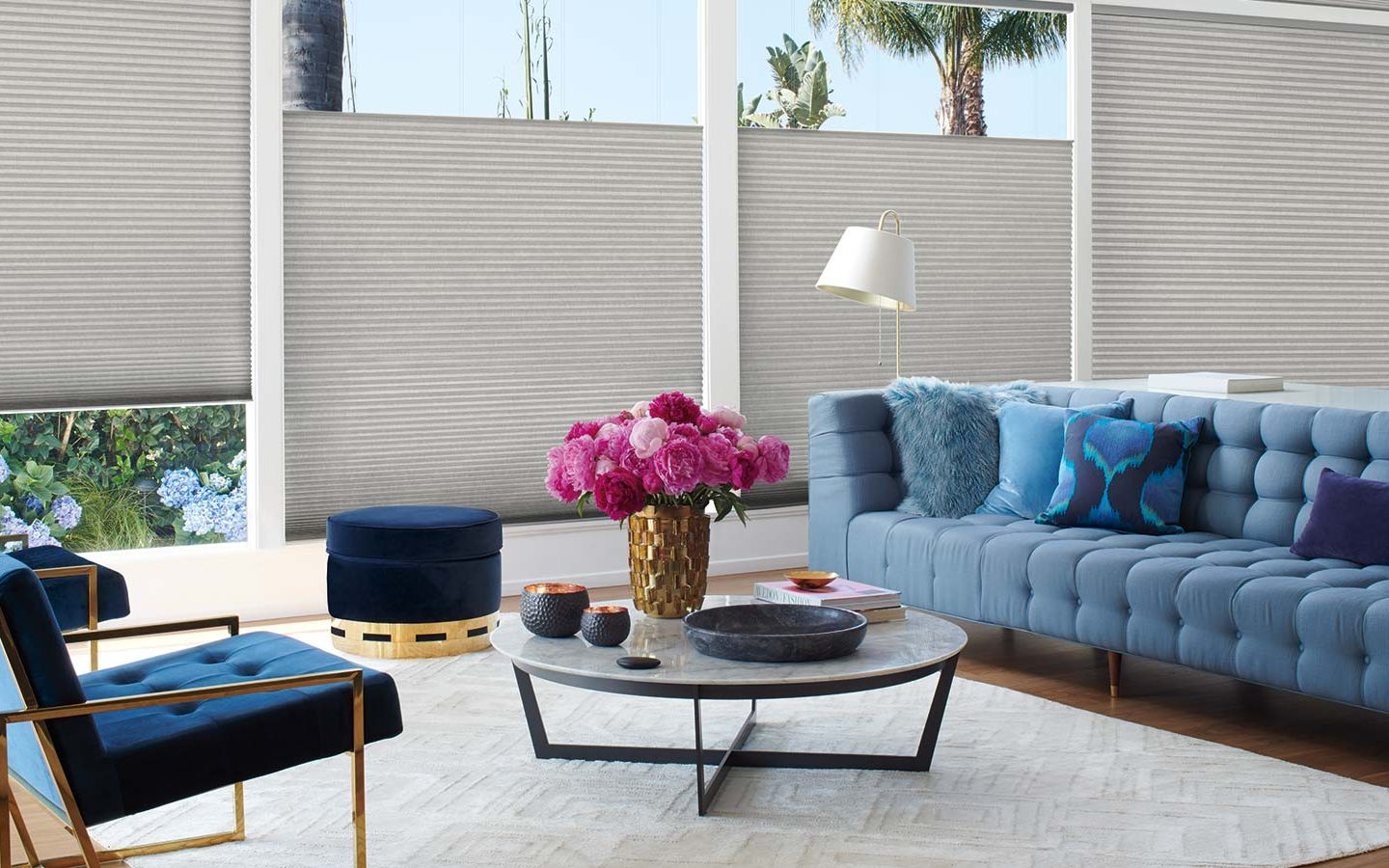 Hunter Douglas Powerview motorized blinds in a well decorated living room