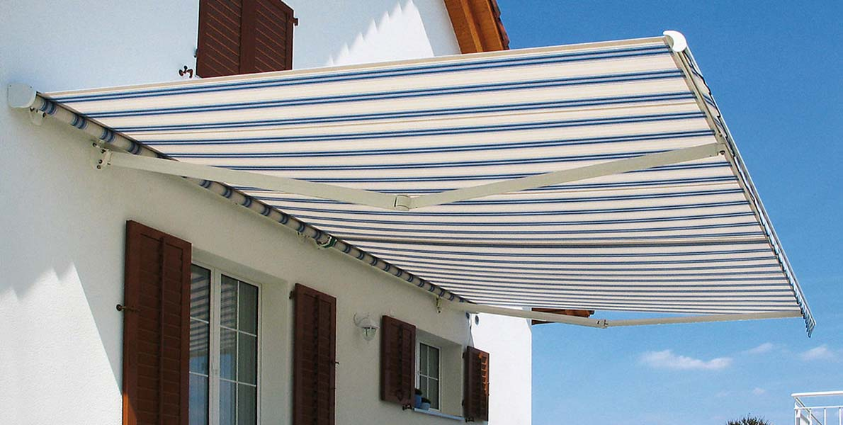Sunshade Blinds & Drapery awning with blue pin-stripes
