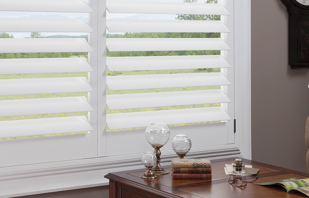 white Hunter Douglas new style hybrid shutters in a home office