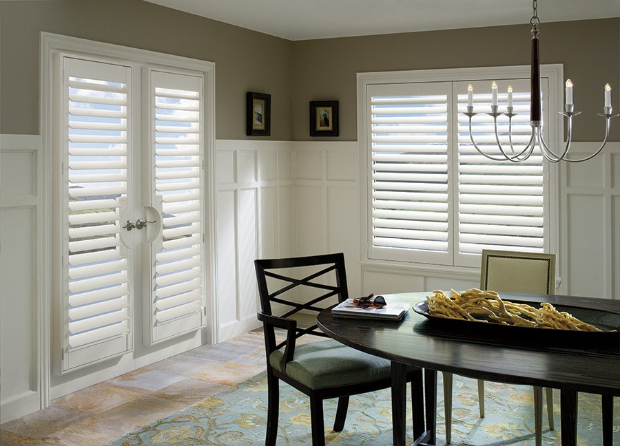 a dining room with Hunter Douglas french door shutters