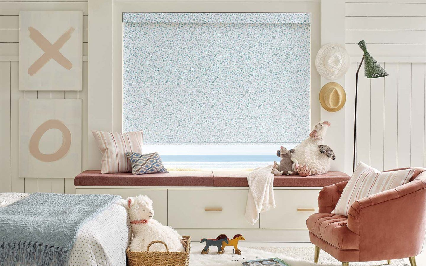 a child's bedroom with Hunter Douglas roller shade blinds covering the window