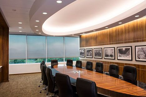 a meeting room with a large office table
