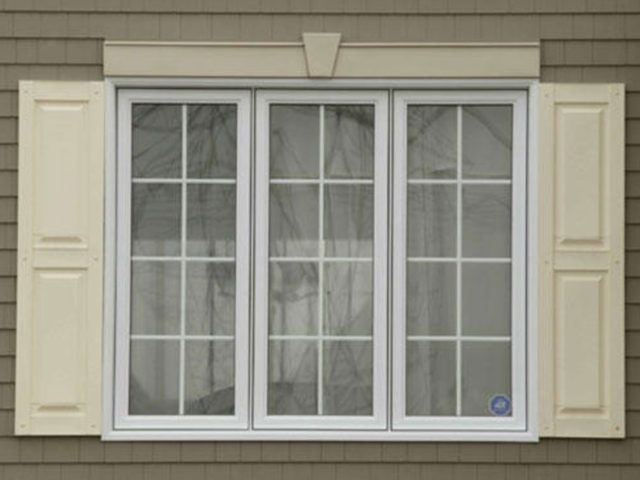 exterior shutters around windows of house
